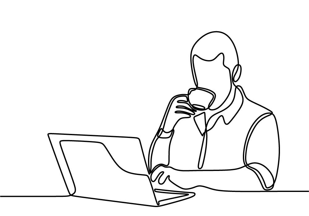 Homme lisant sur un écran d'ordinateur et buvant un café